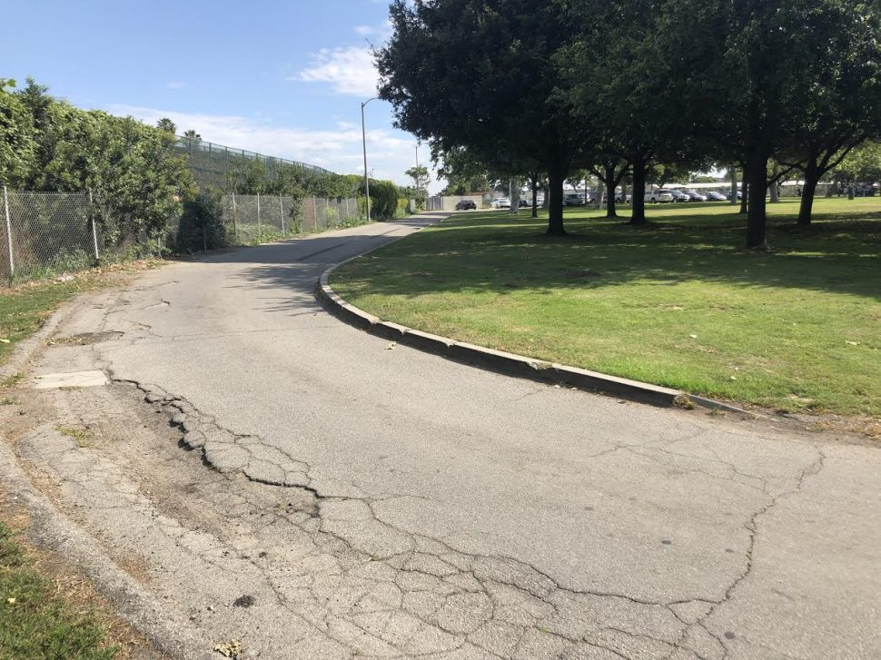 A road at Hudson Park is used as a walking path due to a lack of sidewalk. Community members are asking the city to complete the path as a safer alternative. Photo taken Saturday, May 11, 2019 by Stephanie Rivera.