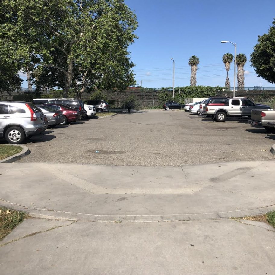 A walking path at Hudson Park that leads pedestrians into a parking lot. Community members are asking the city to complete the path as a safer alternative. Photo taken Saturday, May 11, 2019 by Stephanie Rivera.
