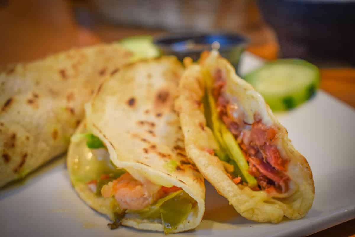 Cheko el Rey del Sarandeado's smoke marlin taco and Gobernador taco. Photo by Brian Addison.